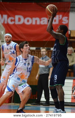 KAPOSVAR, HUNGARY - DECEMBER 10: Gergely Kuttor (10) in action at a Hugarian Cup basketball game Kaposvar vs. Szeged on December 10, 2011 in Kaposvar, Hungary.