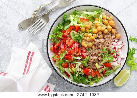 Healthy And Delicious Bowl With Buckwheat And Salad Of Chickpea, Fresh Pepper And Lettuce Leaves. Di