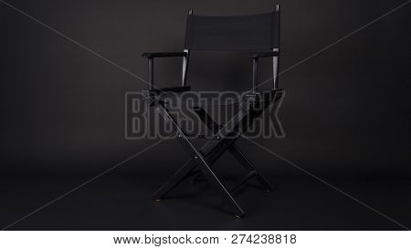 Black Director Chair Use In Video Production , Film, Cinema Industry On Black Background