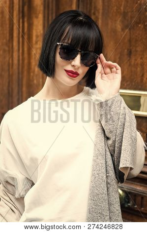 Parisian Fashion Model Pose On Wooden Background. Girl In Fashionable Glasses And Shirt, France. Loo