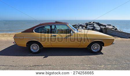Felixstowe, Suffolk, England -  May 06, 2018: Classic Gold 2.0 Litre Ford Capri Ghia Motor Car Parke