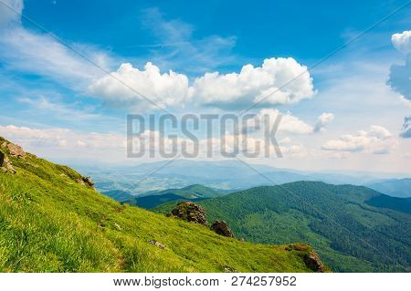 Rock On Grassy Slope Of A Mountain. Beautiful View From The Top Of A Hill. Wonderful Summer Landscap