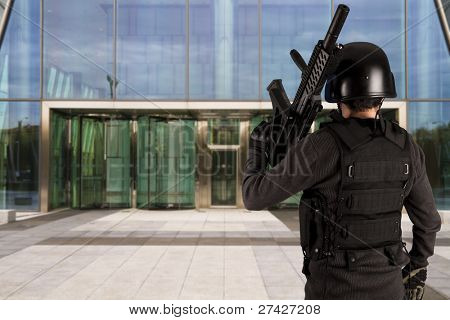 Military defending a business building