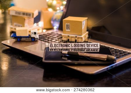 Electronic Logging Device, Eld - Still Life Logistics Business Concept With Laptop, Phone, Mini Ship