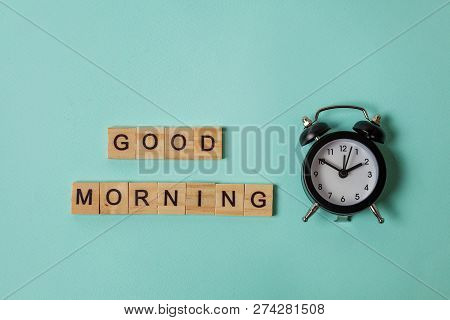 Simply Flat Lay Design Alarm Clock And Inscription Good Morning Letters Word On Blue Pastel Colorful