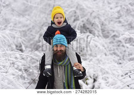 Happy And Happiness. Positive Emotions, Child And Father. Happy Family On The Walk. Boy Sits At His