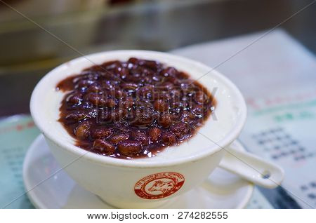 Hong Kong, August, 2018. Hong Kong Red Bean Double Skin Milk Pudding In White Bowl With Yee Shun Mil