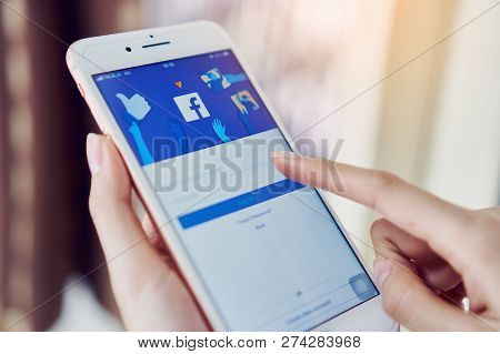 Bangkok, Thailand - December 17, 2018 : Hand Is Pressing The Facebook Screen On Apple Iphone6 ,socia