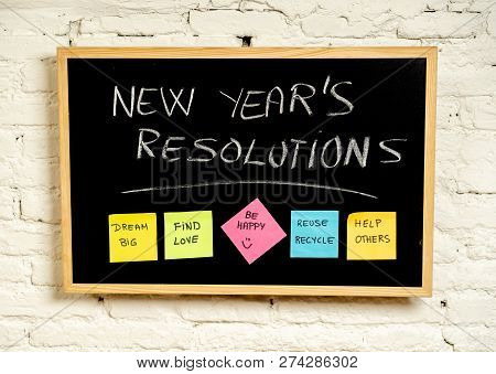 New Year Resolutions Or Popular Goals And Colorful Sticky Post Its Notes On Chalk Blackboard