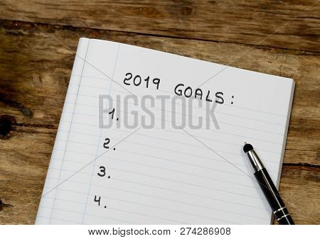 2019 Goal List Copy Space On Notepad And Coffee On Wood Table In New Years Resolution For Happy Life