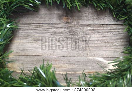 Pine Garland Border On A Wood Background