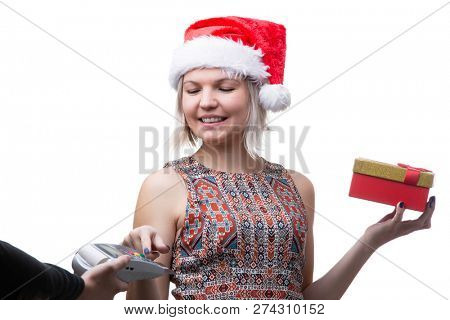 Photo of blonde in glasses and Santa hat with gift and man's hand with terminal for bank card
