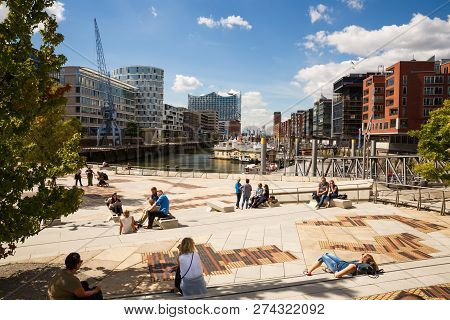 Hamburg, Germany - August 17, 2016 - People Relaxing On The Steps And Benches At Hafencity District.