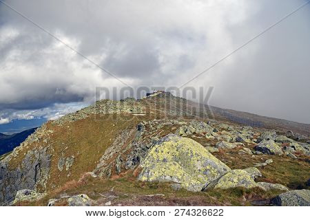 Chopok Mountain Peak With Stones And Meadow In Nizke Tatry Mountains In Slovakia During Autumn Day W