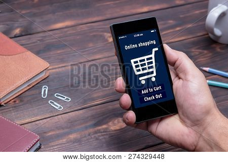 A Man Is Shopping At The Online Store. Shopping Cart Icon. Ecommerce.