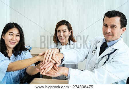 Doctor Hands Holding To Patient Hands  In Hospital