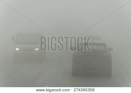 Dense Fog And Poor Visibility On The Road. Dangerous Driving Situations. View On Highway Traffic. Mi