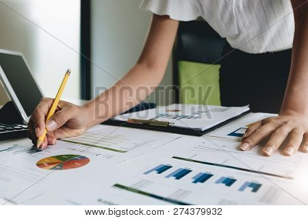 Business Woman Investment Consultant Analyzing Company Annual Financial Report Balance Sheet Stateme
