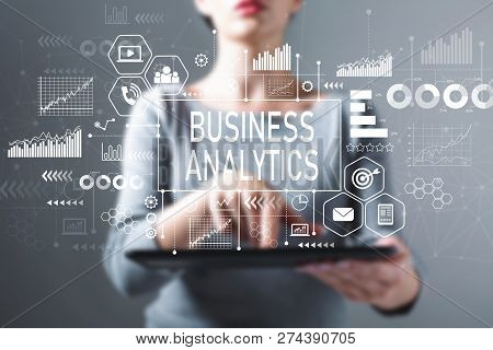 Business Analytics With Business Woman Using A Tablet Computer