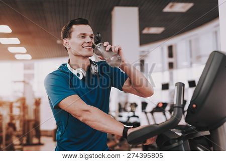 Smiling Young Man On Running Track In Sport Club. Healthy Lifestyle Concept. Sport And Training Conc