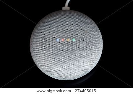 Paris, France - December 17 2018: Overhead View Of A Google Home Mini With Cable (chalk Color), Blac