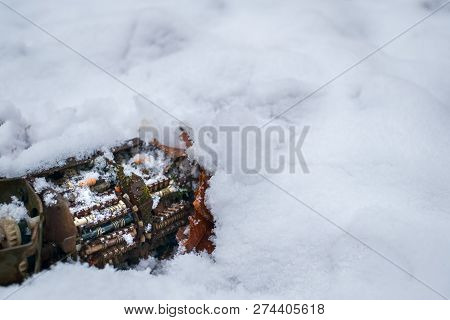 Old Tv Tuner Channel Selector With Moss In Snow