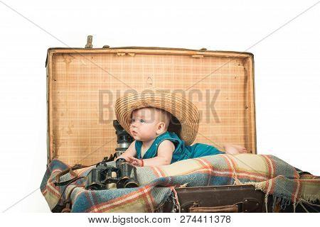 Taking Care Of A Baby. Small Girl In Suitcase. Traveling And Adventure. Portrait Of Happy Little Chi