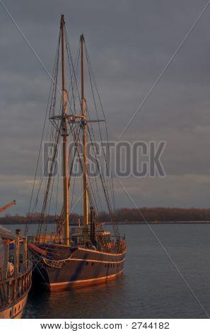 Sunset Falling On Sail Boat