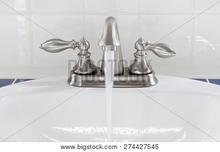 Brushed Nickel Faucet with Running Water
