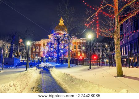 Boston public garden and state house illuminated for Christmas