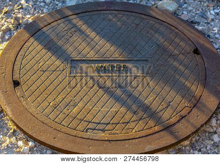 Man Hole Lid With Label Of Water On The Front