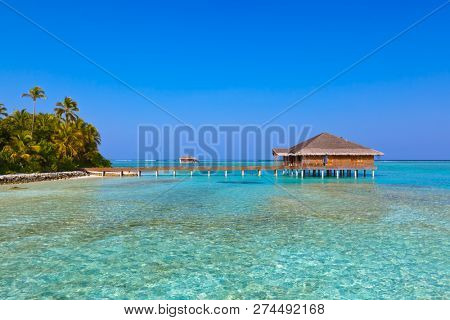 Spa saloon on Maldives island - nature travel background poster
