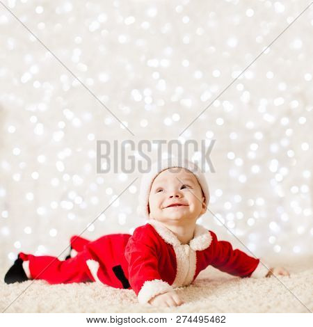 Little Santa Baby Over Defocused Lights Wall