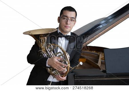 French Horn Player. Hornist Playing Brass Orchestra Music Instrument. Isolated Image On White Backgr