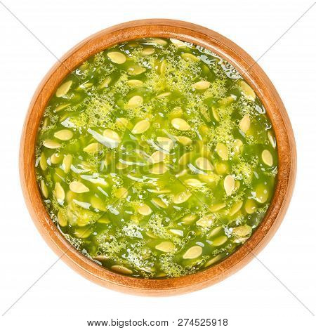 Kiwano Pulp In Wooden Bowl. Lime Green, Jelly-like Flesh Of Horned Melon, Also African Horned Cucumb