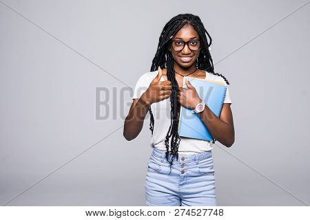 College Student Young African American Woman With Notebook In Hands Isolated On Gray Background