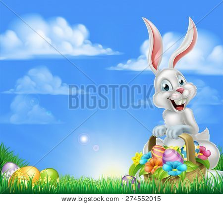 White Easter Bunny With A Basket Full Of Decorated Chocolate Easter Eggs In A Field Easter Backgroun