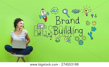 Brand Building With Young Woman Using A Laptop Computer