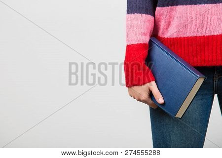 Confident Smart  Student Girl Holding Book In One Hand Over White Background.close Up Of A Student H