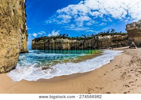 Magnificent beach  in ocean fjord of Pacific ocean. The Great Ocean Road of Australia. The concept of exotic, active and photo-tourism