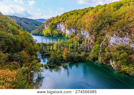 Autumn trip to Croatia. Plitvice cascading lakes with emerald water among the low hills. The concept of ecological and active tourism