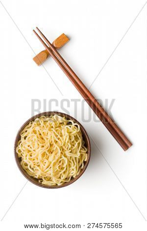 Cooked chinese instant noodles in bowl and chopsticks isolated on white background.
