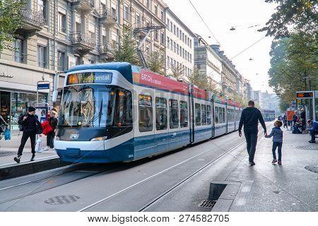 Zurich, Switzerland - December 17, 2018: Electric Blue Tram In The City Center Of Zurich With Local
