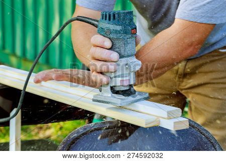 Carpenter Hands Of With Electronic Plunge Router In The Workbench In Carpentry, Take Me To Work