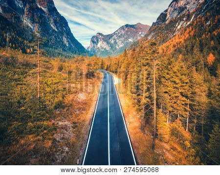 Aerial View Of The Road In Mountain Forest At Sunset In Dolomites. Top View Of Perfect Asphalt Roadw