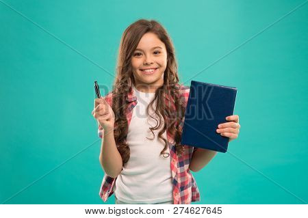 I Am Ready For School. Child Smart Kid Hold Pen And Notepad. Girl Cute Happy Face Likes To Study Blu