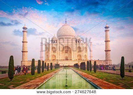 Taj Mahal. Indian Symbol and famous tourist destination - India travel background. Agra, India