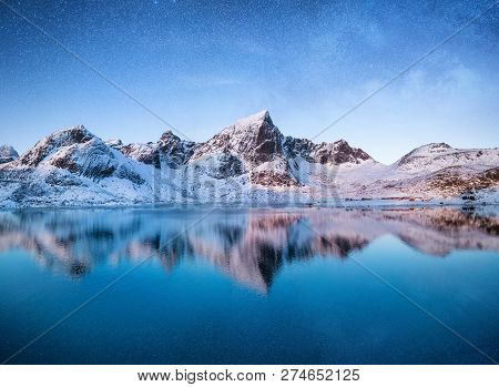 Mountains At The Night Time. Mountains And Reflections On The Water Surface On Lofoten Islands, Norw