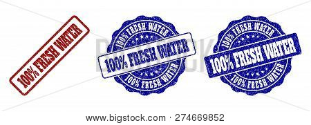 100 Percent Fresh Water Grunge Stamp Seals In Red And Blue Colors. Vector 100 Percent Fresh Water Wa
