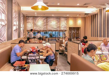 Bangkok, Thailand - December 16: Unidentified Asian Family Enjoys Food In Yayoi Japanese Restaurant